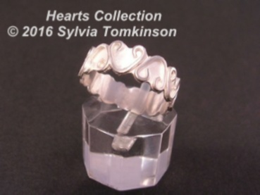 Silver jewellery with a decoration of hearts.