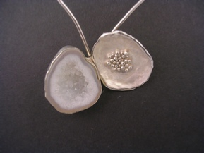 Silver jewellery with a Druzy stone set in oyster shell style.