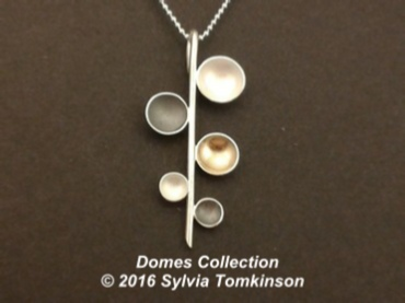 Domes Collection Silver with Gold Plating and Oxidization.